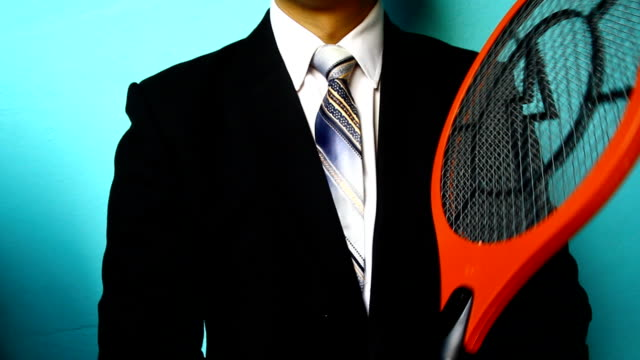 businessman hand with mosquito swatter - fly swatter stock videos & royalty-free footage