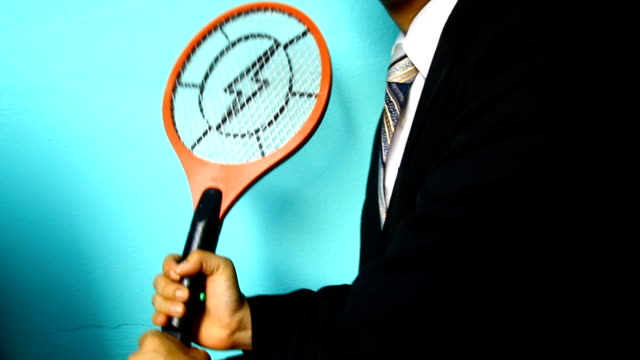 businessman hand with mosquito swatter - fly swat stock videos & royalty-free footage