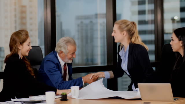 businessman happily sign a document and shake hands. - subordination stock videos & royalty-free footage