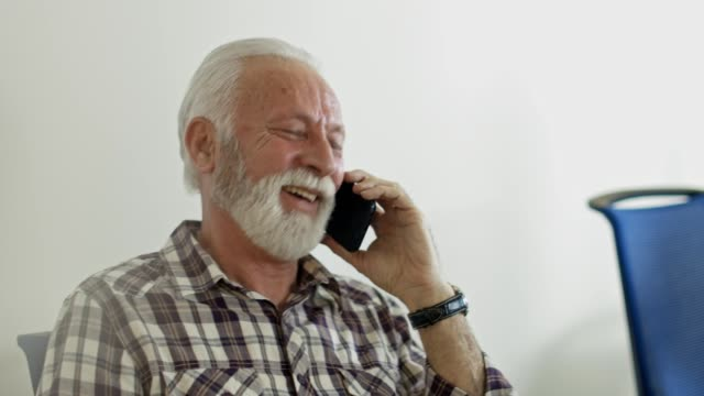 businessman has a phone call - one senior man only stock videos & royalty-free footage