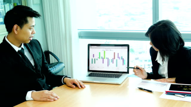 Businessman Having a Presentation on Laptop to her Boss