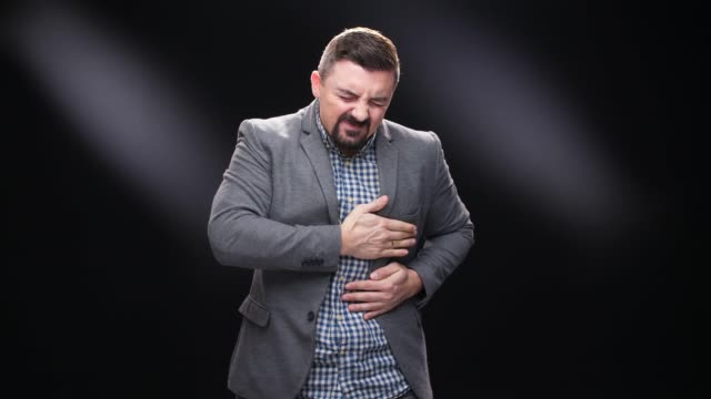 businessman having heartache chest pain health issues - overweight doctor stock videos & royalty-free footage