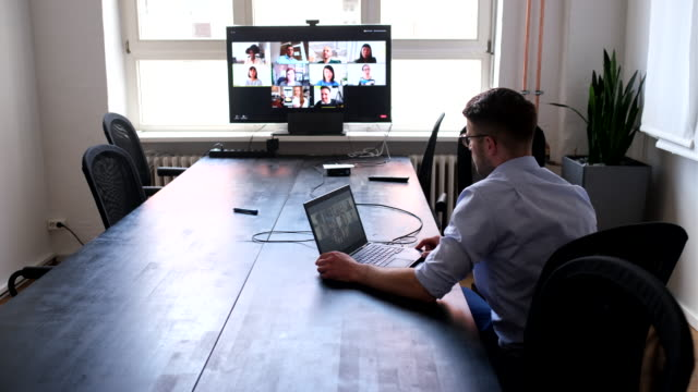 businessman having online briefing with team - video call stock videos & royalty-free footage