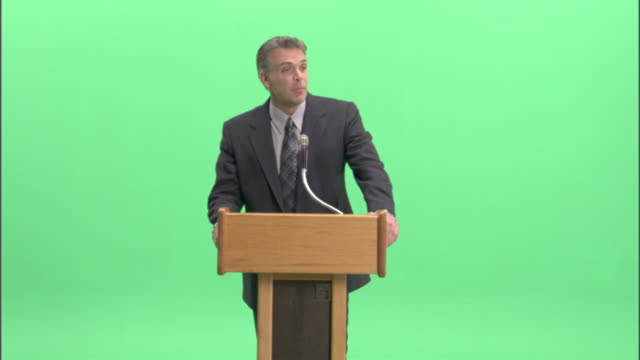 MS, Businessman having speech at podium in studio