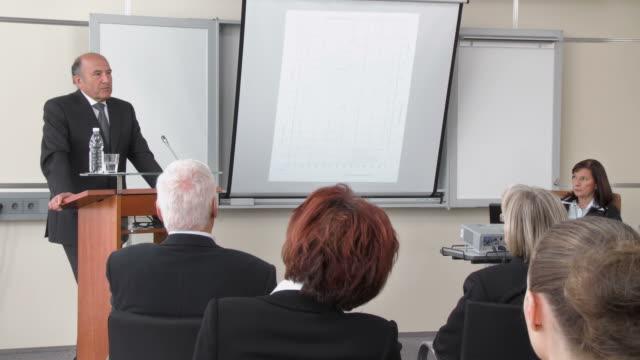 hd: businessman having speech - formal businesswear stock videos & royalty-free footage