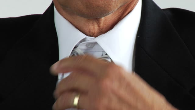hd: businessman heating up - collar stock videos and b-roll footage