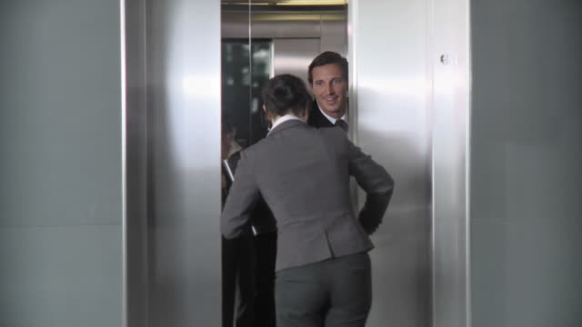 HD: Businessman Holding Elevator Door