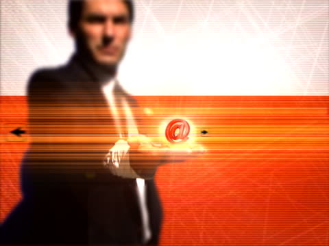 businessman holding glowing 'at' symbol - one mid adult man only stock videos & royalty-free footage