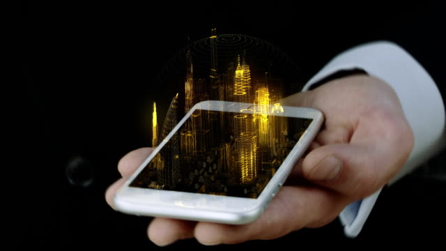 Businessman holding phone with 3D city hologram