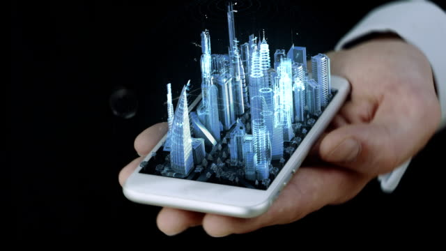 businessman holding phone with 3d city hologram - intelligence stock videos & royalty-free footage