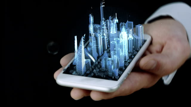 Businessman holding phone with blue transparent 3D city hologram