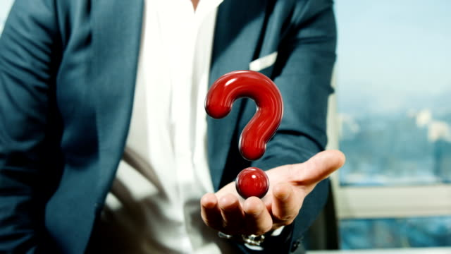 businessman holding qestion mark - question mark stock videos & royalty-free footage