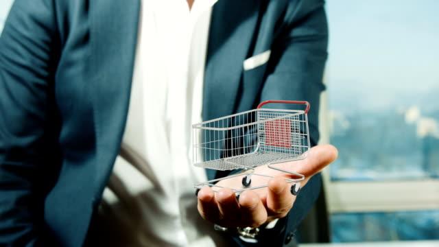 Businessman Holding Shopping Chart