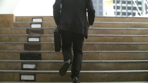 businessman in a hurry running, he is late for his business appointment.focusing on his briefcase.case. - steps and staircases stock videos & royalty-free footage
