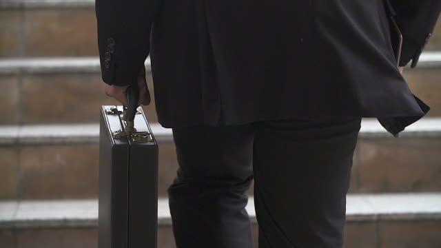 businessman in a hurry running up stairs, he is late for his business appointment.focusing on his briefcase. - briefcase stock videos & royalty-free footage