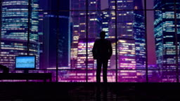 Businessman in an office on a background of night skyscrapers