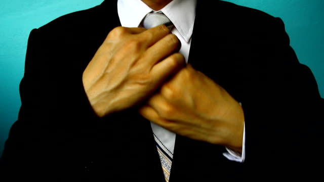 businessman in black costume tie one's necktie - cravat stock videos and b-roll footage
