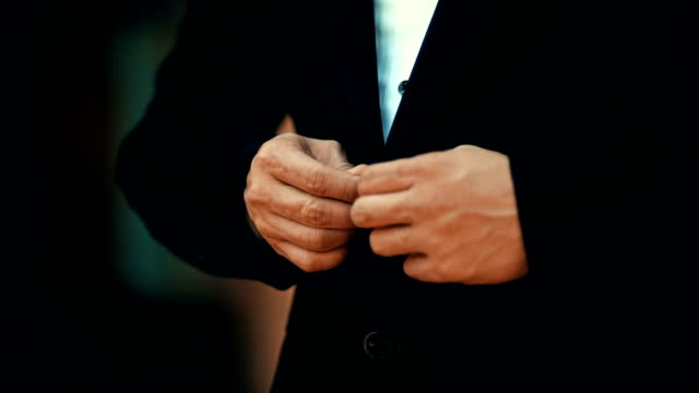 a businessman in black suit with buttoning his jacket. - suit jacket stock videos & royalty-free footage