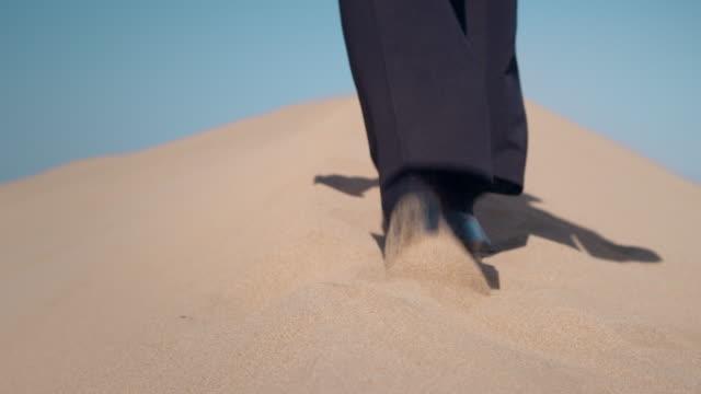 businessman in desert - footprint stock videos & royalty-free footage