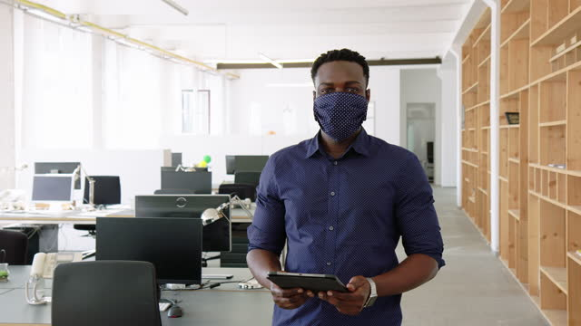 businessman in face mask holding digital tablet - safety stock videos & royalty-free footage