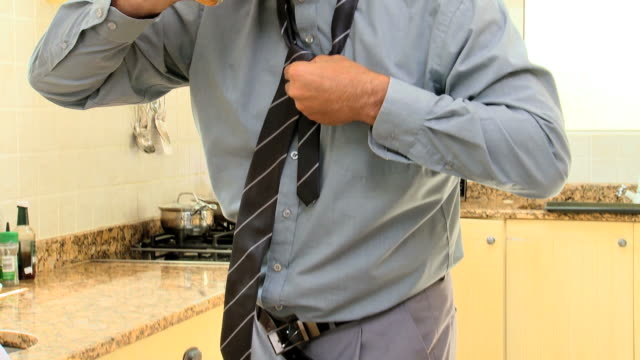 businessman in kitchen getting dressed quickly / cape town, western cape, south africa - necktie stock videos & royalty-free footage