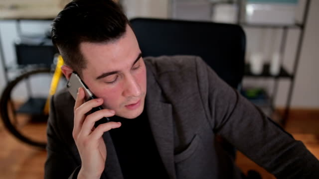 Businessman in office talking on the phone
