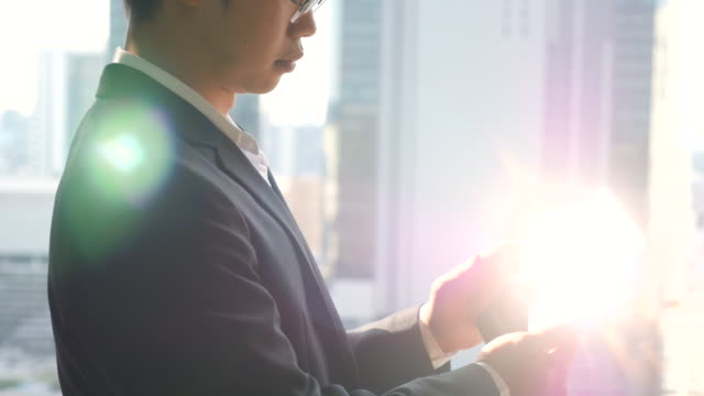 Businessman in office working on digital tablet