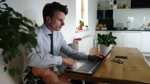 ws businessman in pajamas telecommuting at home - pajamas stock videos & royalty-free footage