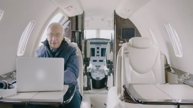 Businessman in private jet airplane