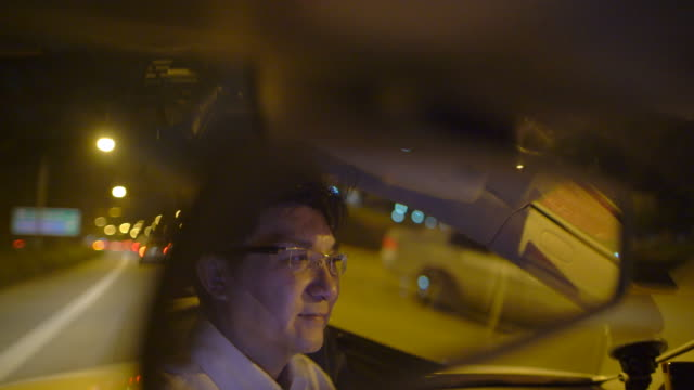 ms businessman in rear view mirror of car in city at night - 10 seconds or greater stock videos & royalty-free footage