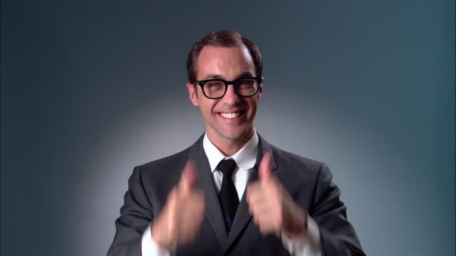 ms businessman in suit and glasses giving thumbs up and ok sign/ new york city - medium shot stock videos & royalty-free footage