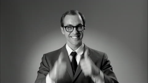 b/w ms businessman in suit and glasses giving thumbs up and ok sign/ new york city - thumbs up stock videos & royalty-free footage