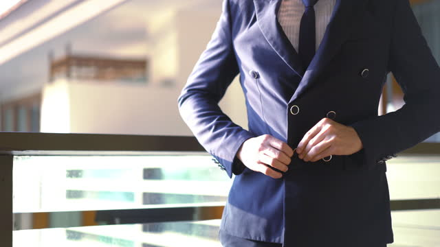 businessman in suit fastening button at the hotel - jacket stock videos & royalty-free footage