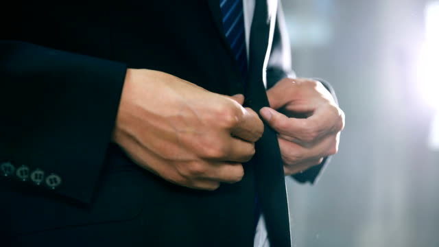 businessman in suit fastening button on jacket - adjusting stock videos & royalty-free footage