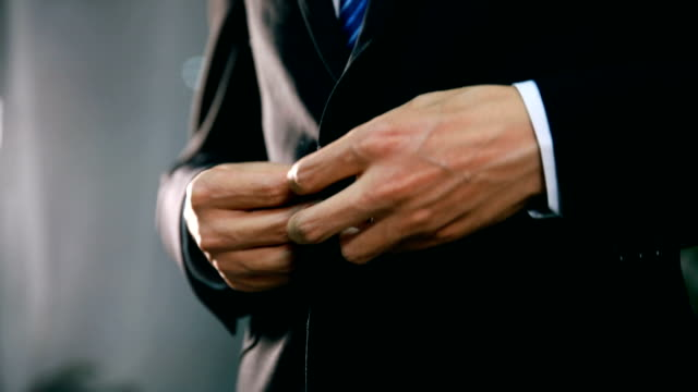 businessman in suit fastening button on jacket - suit jacket stock videos & royalty-free footage