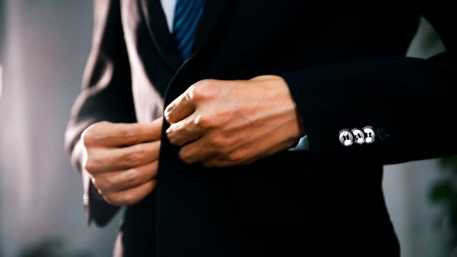 businessman in suit fastening button on jacket - necktie stock videos & royalty-free footage