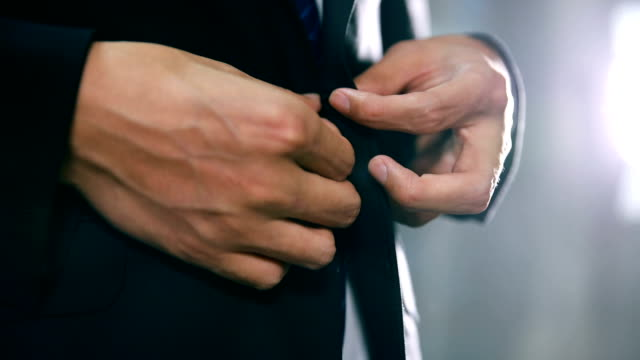 businessman in suit fastening button on jacket - tie stock videos & royalty-free footage