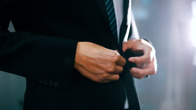 businessman in suit fastening button on jacket - tie stock videos and b-roll footage