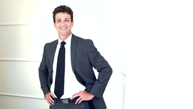 Businessman in suit smiling at camera