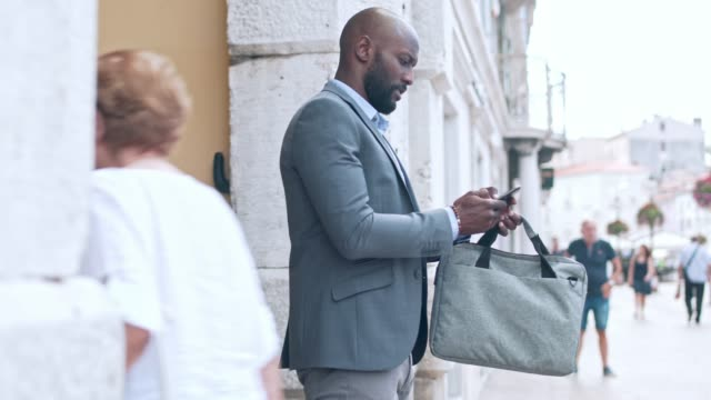 businessman in the city - laptop bag stock videos and b-roll footage