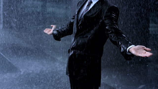 businessman in the heavy rain - arms raised stock videos & royalty-free footage