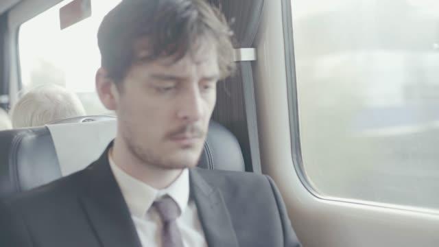 vídeos y material grabado en eventos de stock de businessman in train - barba de tres días