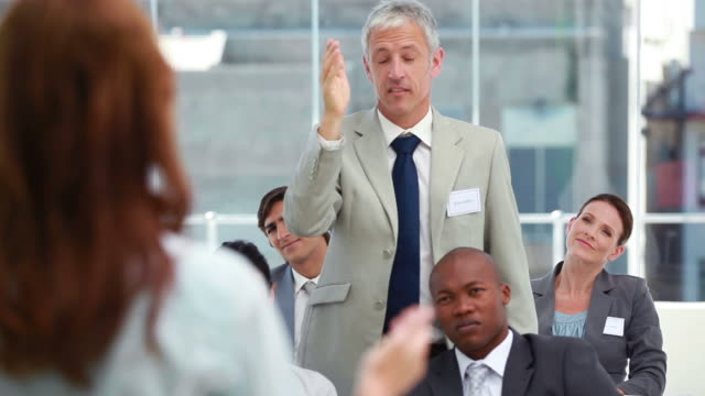 businessman intervening at a meeting - employee engagement stock videos & royalty-free footage