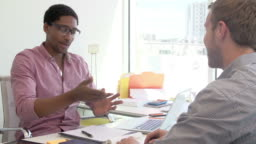 Businessman Interviewing Candidate For Job In Design Agency