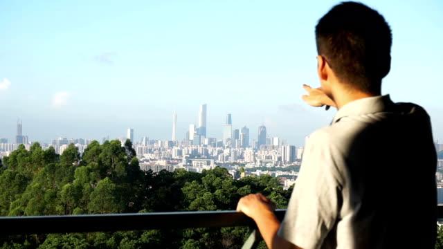 Businessman introduce cityscape