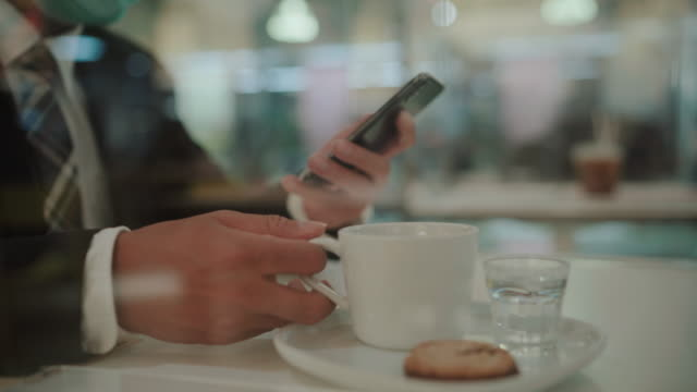 businessman is using him smartphone - coffee drink stock videos & royalty-free footage