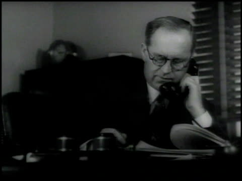 businessman joseph kennedy at desk using telephone cu fdr stationary w/ note broken pen joseph kennedy sitting at desk sot asking what they need how... - franklin roosevelt stock videos & royalty-free footage