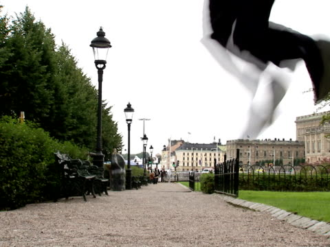 a businessman jumping in a park stockholm sweden. - only mid adult men stock videos & royalty-free footage