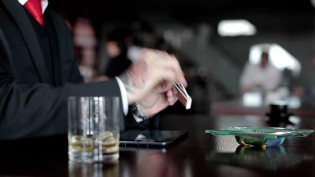 businessman lighting cigar - scotch whiskey stock videos and b-roll footage