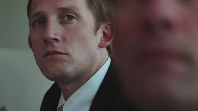 businessman listens in meeting. - formelle geschäftskleidung stock-videos und b-roll-filmmaterial